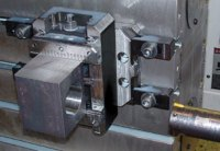 A PositiveLock system CenterCompact vise mounted on a QuickPoint base plate is a very secure way to hold a workpiece, as is shown in this demonstration. Using the QuickPoint base plate, the workpiece can also easily be turned 90 degrees for additional operations.