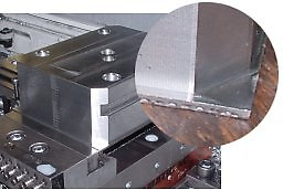 In machining CenterCompact vise bodies, only 0.08 (2 mm) of the raw material is held in PositiveLock vise jaws. The body is completely machined on 5 sides, and then conventionally clamped to remove the extra 0.08 of material.